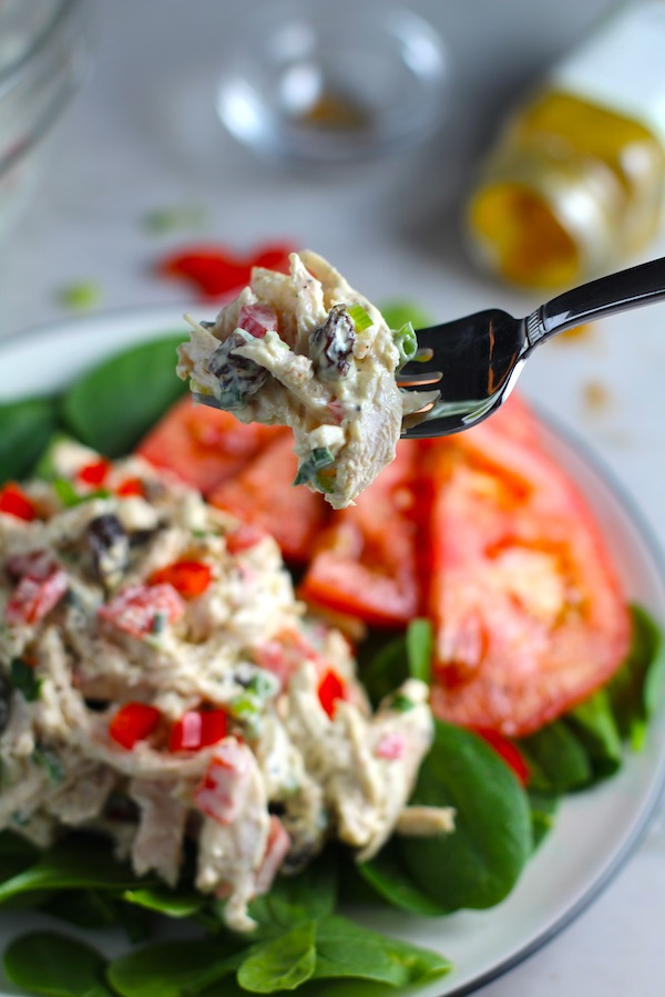 Craveable Curry Chicken Salad has so many fantastic flavors and textures!  The chicken breast is simply roasted and mixed with a creamy sweet and savory curry dressing.  Red pepper gives you a fresh crunch, scallion gives a savory bite, and raisins give a burst of sweet.  #chicken #chickenrecipes #chickensalad #currychicken #mealprep #lunch #healthyrecipes
