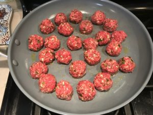 Raw meatballs in skillet for Meatballs in Cauliflower Dill Cream Sauce. #meatballs #swedishmeatballs #familydinner #easydinner #dinner #healthydinner