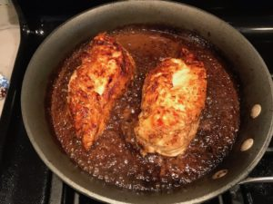 Cooked Chicken in sauce in skillet for Sesame Sweet Chili Chicken recipe. It is slightly sweet, tangy, savory, nutty, with a touch of heat. You can prepare it days ahead, it takes just minutes to prepare, minutes to cook, and everyone will love it!! #chicken #marinades #easydinner #easychicken #chickenrecipes #easysauces #healthydinner #healthyfood #healthyrecipes