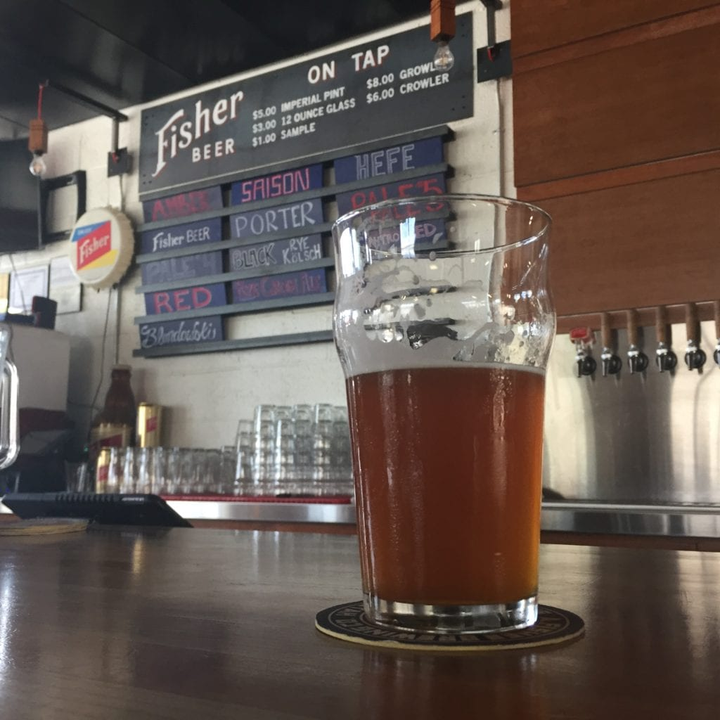 Sipping a pint of beer at A. Fisher Brewing Company. A Salt Lake icon from its founding in 1884 until the mid-1950s, Fisher Brewing re-opened in 2017.
