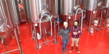 Roosters Brewing Co.'s Head Brewer Jacquie King, left, and Brewery Engineer Colton Layton.