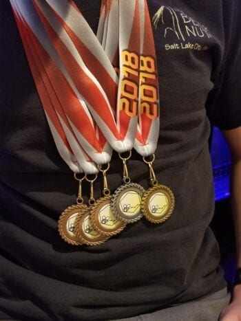 Homebrewer Chaz Smith displays medals won at the 2018 Beehive Brewoff homebrew competition.