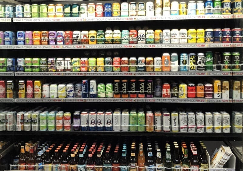A fully stocked cold case of beer at a Harmons Grocery Store in January 2020.