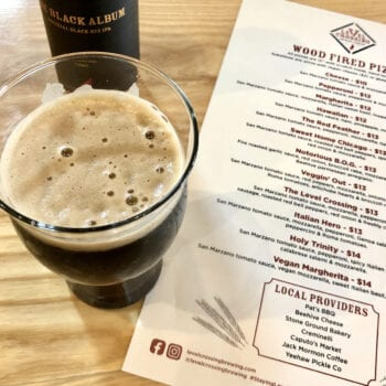 The Black Album, an Imperial Black Rye IPA, is the second in Level Crossing Brewing's Red Feather Small-Batch Series.