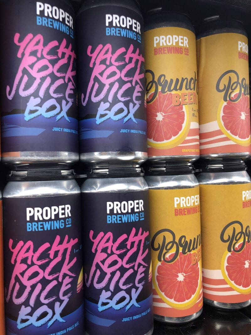 Proper Brewing beers on grocery store shelves in 16-ounce cans.