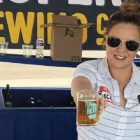 Rebecca Cardaccio, sales director for Proper Brewing Co. in Salt Lake City, serves a beer at the Utah Beer Festival in 2019.