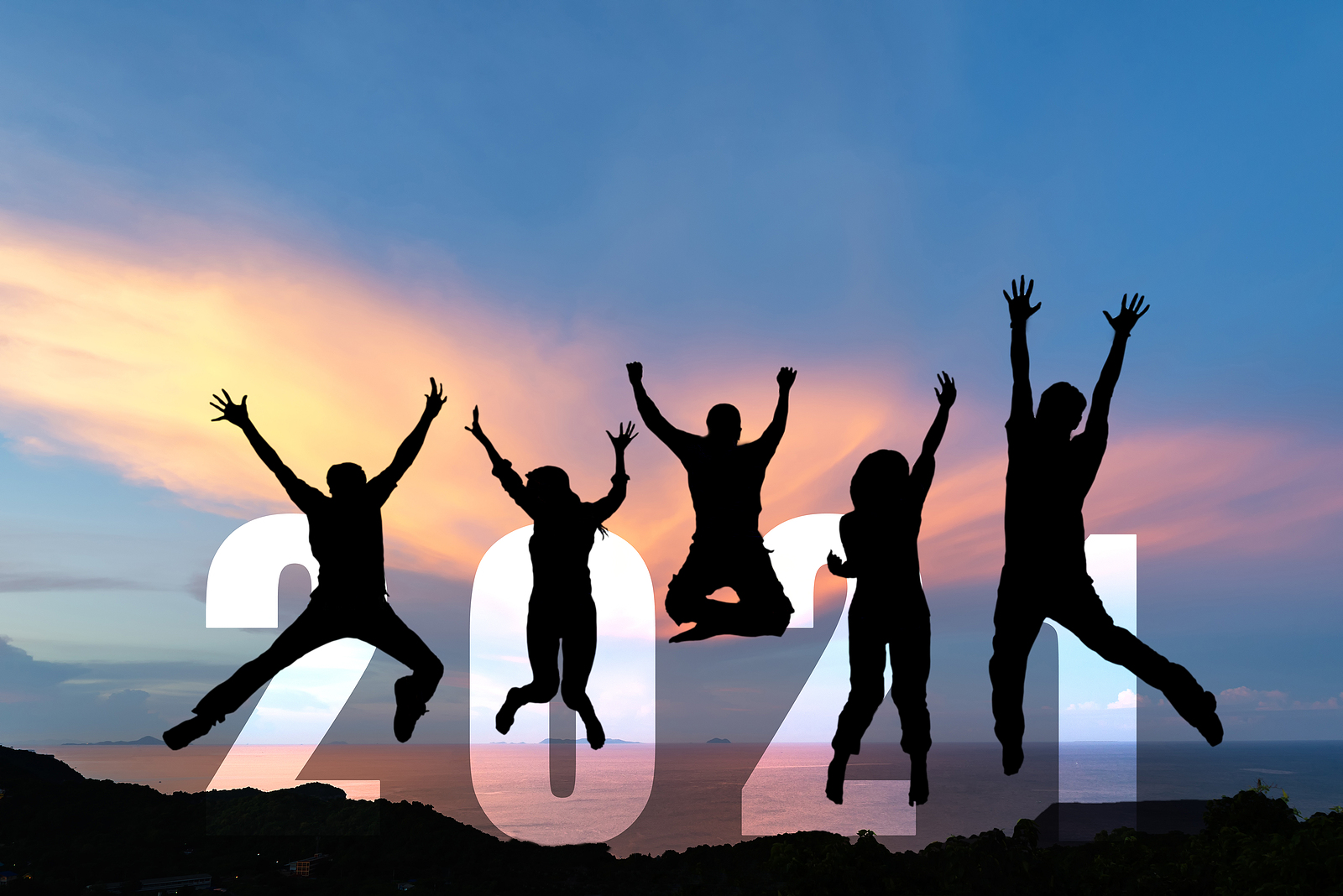 Silhouette happy business teamwork jumping congratulation and celebrate in Happy New year 2021 for change new life future concept. Freedom lifestyle group people team jump as part of Number 2021 success at the sunset beach outdoor