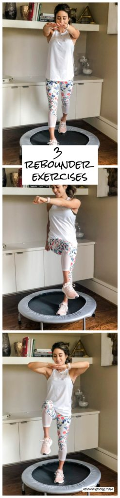 fitness blogger using a small rebounder/mini trampoline in floral printed workout leggings from Fabletics and a white tank sharing a workout at home | adoubledose.com