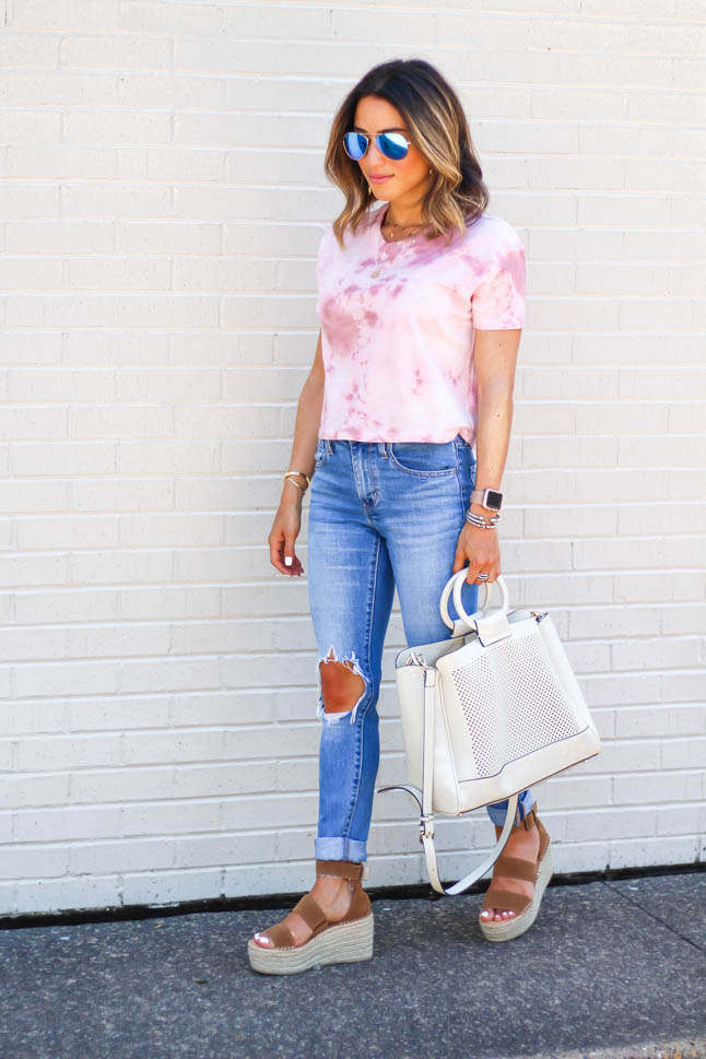 Fashion Blogger wearing ripped levis jeans with a tie dye cropped top and neutral wedges | adoubledose.com