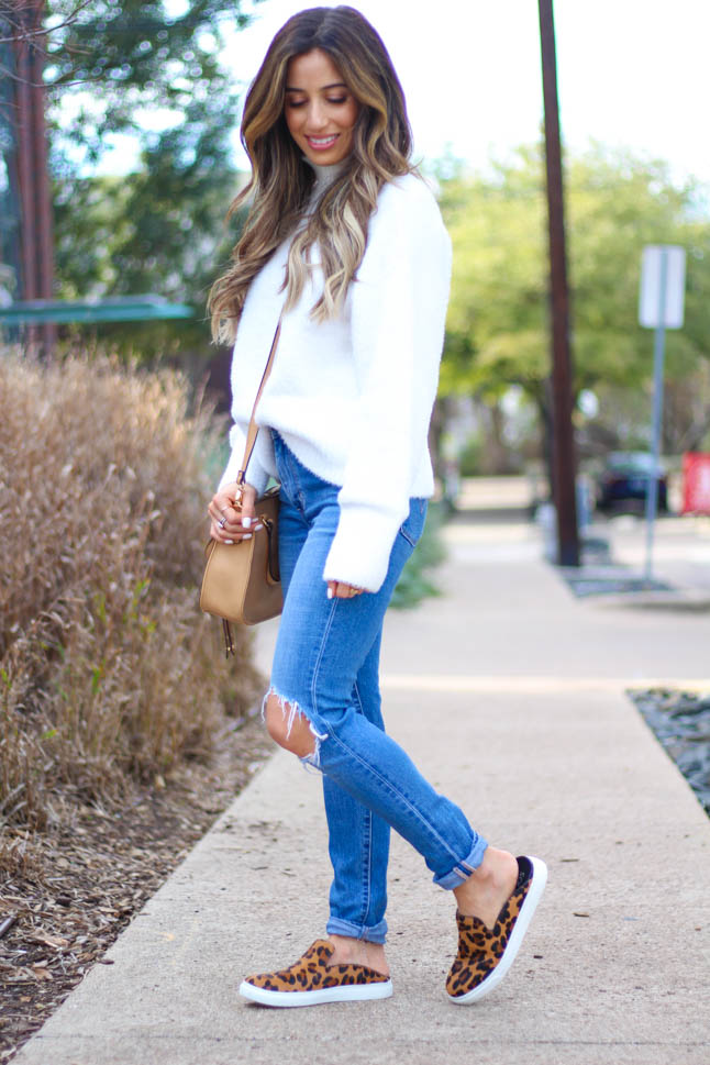 lifestyle and fashion blogger samantha belbel wearing a cozy ivory turtleneck sweater from revolve with levis ripped jeans, leopard sneaker mules from sole society, satchel crossbody bag from sole society, and a neutral scarf | adoubledose.com