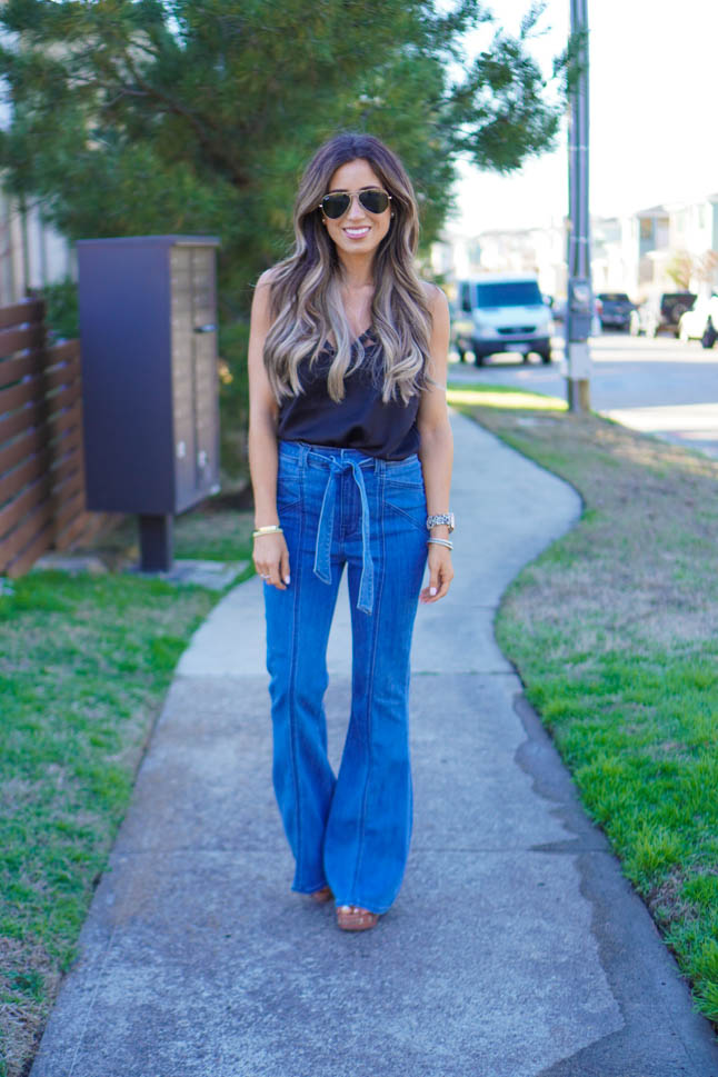 lifestyle and fashion blogger samantha belbel wearing flare jeans and a black lace cami with wedges from Express sharing what is in vs out in fashion spring 2020 trends    adoubledose.com