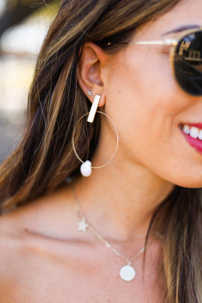 lifestyle and fashion blogger samantha belbel sharing 20 things you can do at home besides watching tv, wearing a floral off shoulder maxi dress from express with gold hoop earrings from express | adoubledose.com