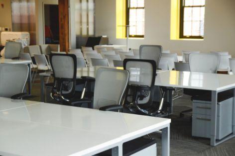 multiple empty desks in an office room