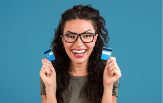 Woman cutting credit card and being debt free