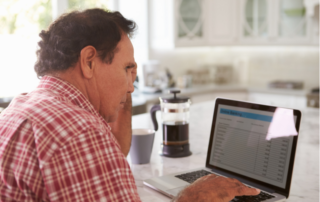 Concerned man reading email from debt collector