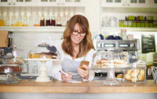 Bakery business owner checking order