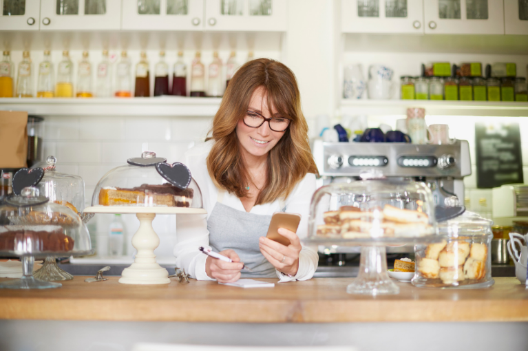 Bakery business owner checking order