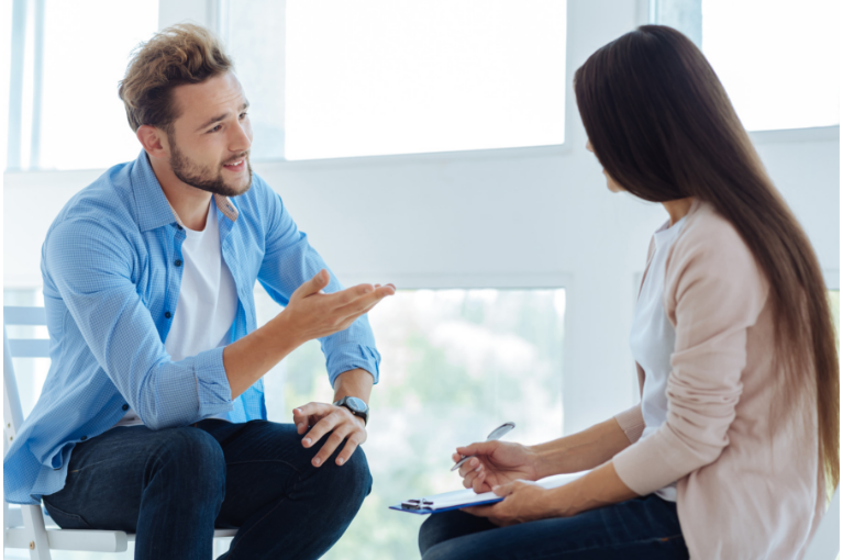 Woman and man discussing over debt