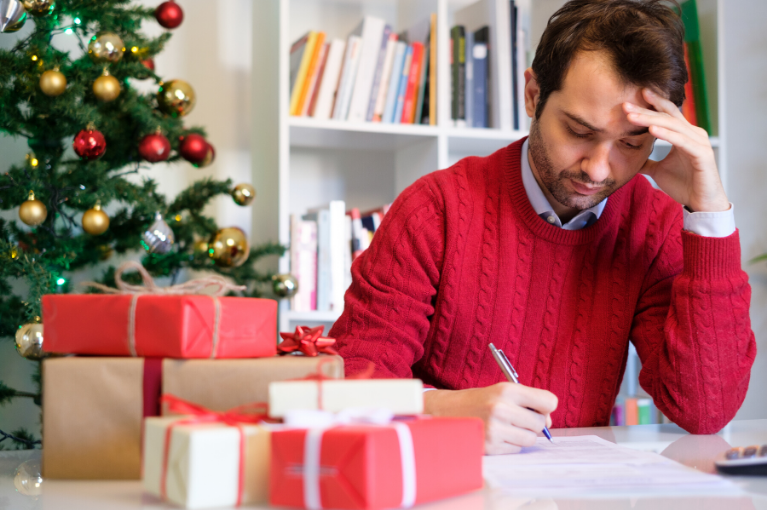 Worried man for overspending for Christmas presents
