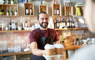 Man serving coffee to go