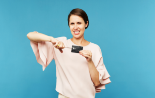 Woman cutting credit card