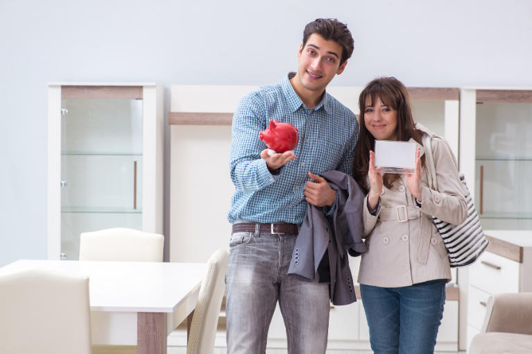 Young couple with a piggy bank