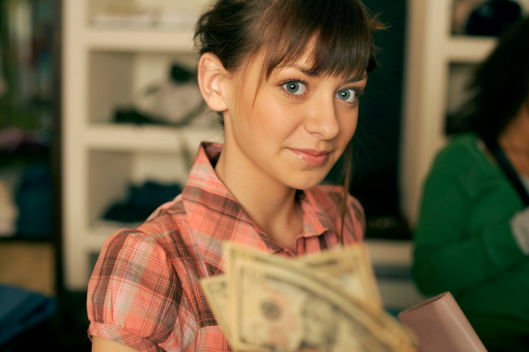 Teenage girl looking at money