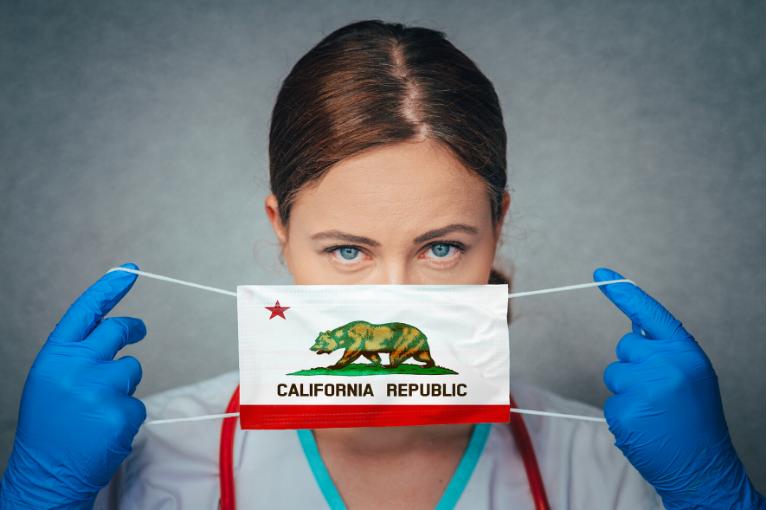 Woman wearing the California state symbol mask
