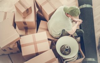 Man surrounded by lots of boxes