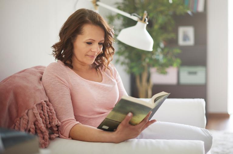 Lady reading on a sofa