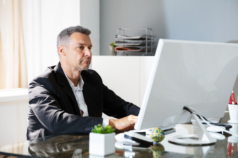 Debt collector at a computer