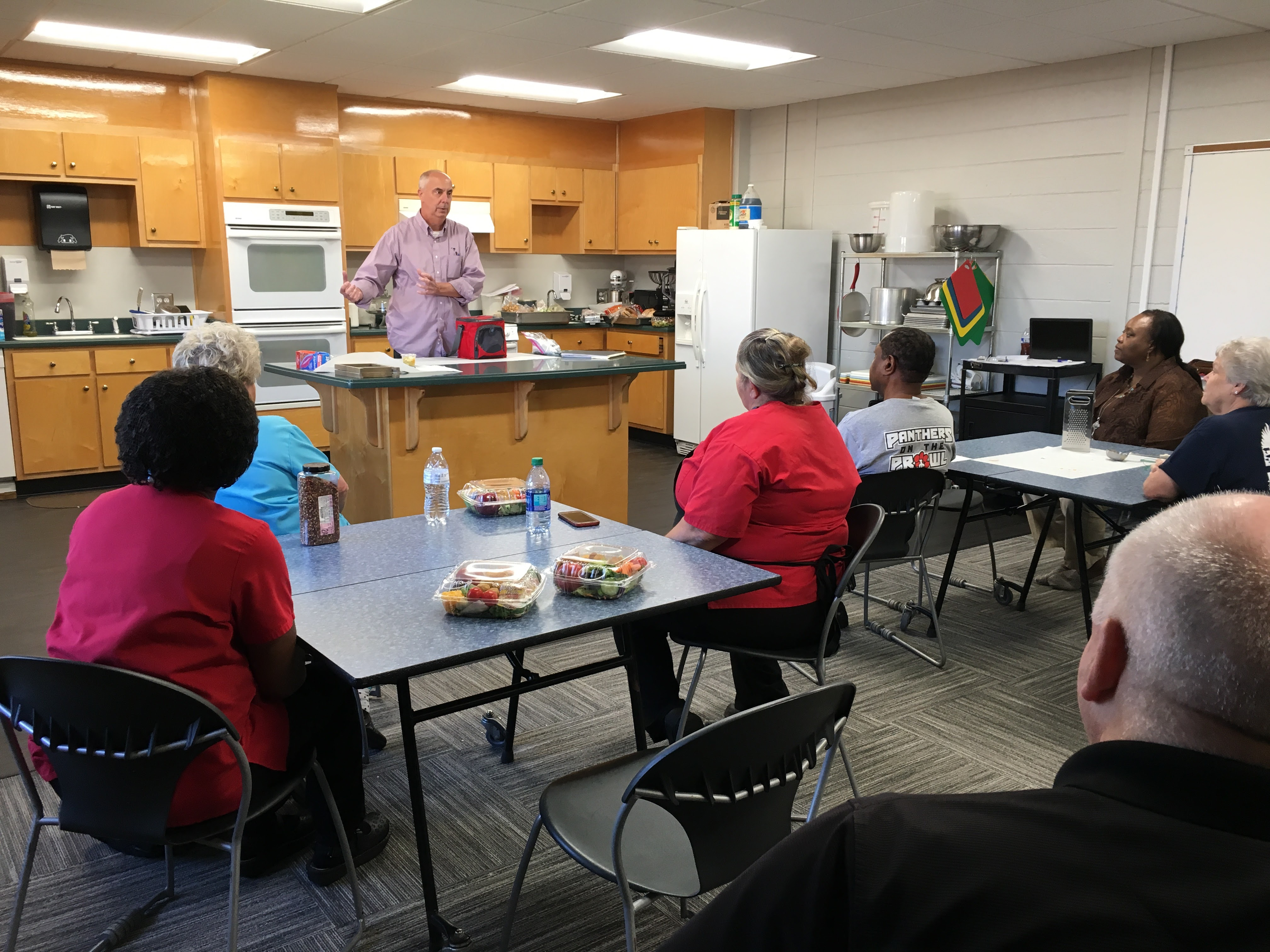 Mark Hungarland talked to the school nutrition managers about his Georgia-grown products, and he cited increasing interest in locally-sourced food and the history and heritage of pickling. The managers met Sept. 20 in the Gordon Street Center's test kitchen.