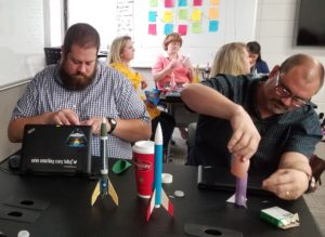 """ROCKET BUILDERS - East Jackson Middle School teachers Thomas Layfield, left, and Robert Andrews build model rockets in a variety of formats during a week of professional learning funded by a Math & Science Partnership Grant. They are among the staff presenting a hands-on, interactive """"museum"""" Monday night at South Jackson Elementary School."""