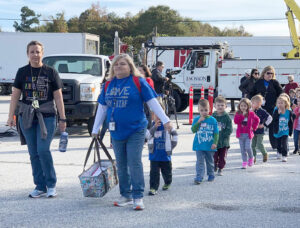 Parents and staff from Gum Springs Elementary School led their students from the Jackson EMC demonstration to their next station.