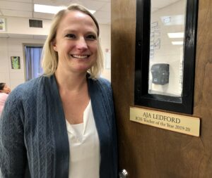 Aja Ledford, the school system's teacher of the year, has a plaque on her door noting that honor.