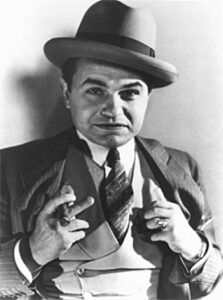 An image of actor Edward G Robinson portraying a 1930's gangster