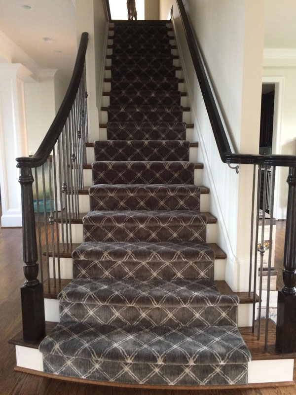 Modern Staircase with Patterned Grey and White Stair Runner Triangular Shapes