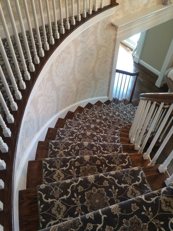 Beautiful Curved Staircase with Patterned Grey and White Stair Runner