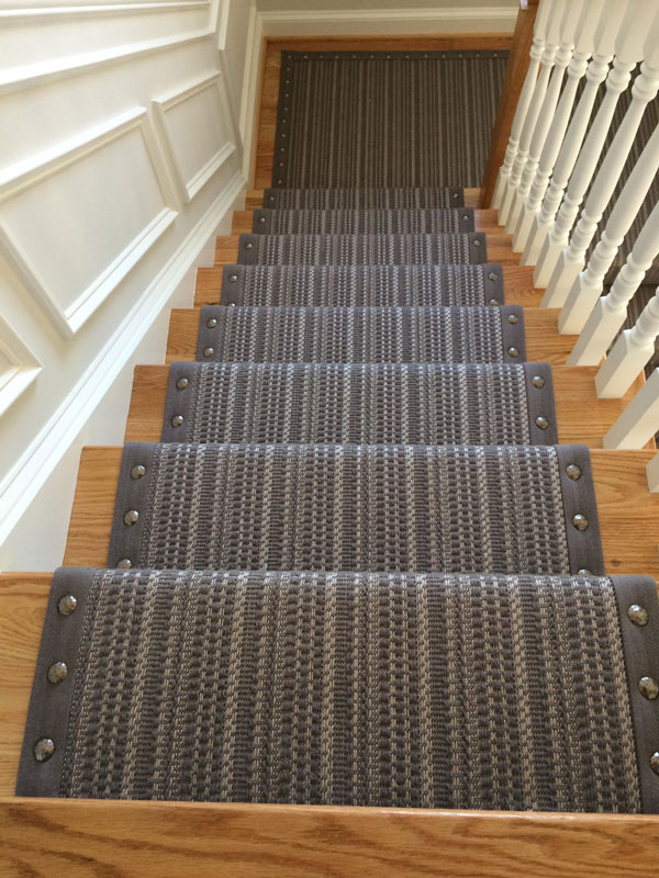 Looking down at Striped Gray Carpet with Rivet Edging