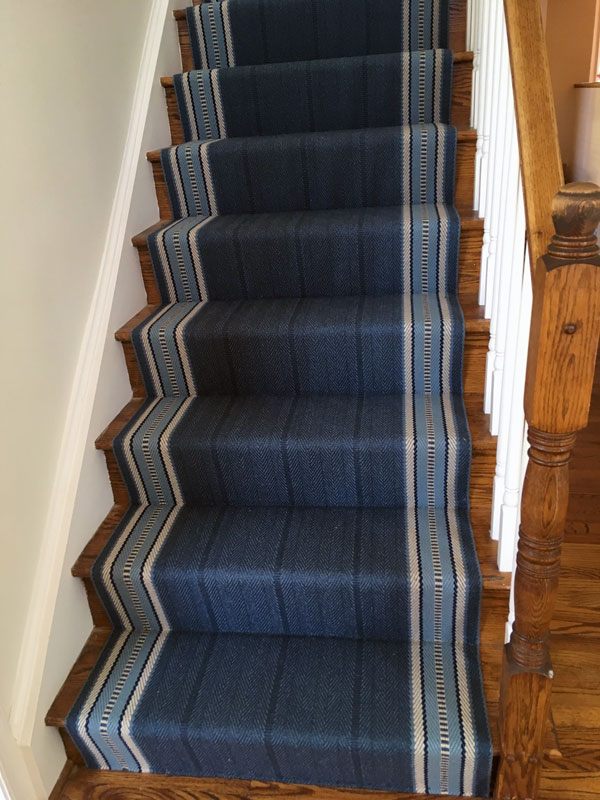 Wood stairs covered by Different Shades of Blue on a Straight Stair