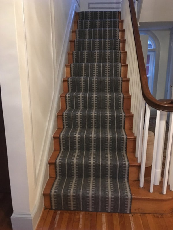 Example of Dark Striped Carpet Runner on Hardwood Staircase by Farsh Carpets & Rugs