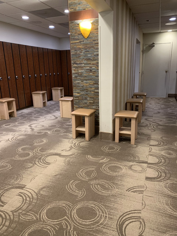 Commercial Locker Room Carpeting with Circle Elements by Farsh Carpets