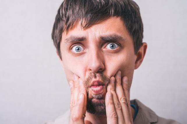man pressing his cheeks 4
