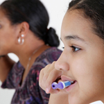 mother and daughter brushing their teeth 4
