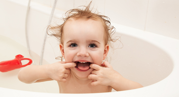 baby showing teeth in bath tub 3