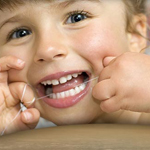 Dental Flossing Tips by Pediatric Dentist in Katy