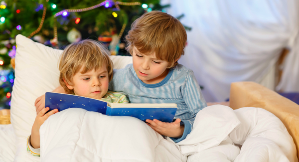 little boys reading a story in bed 4