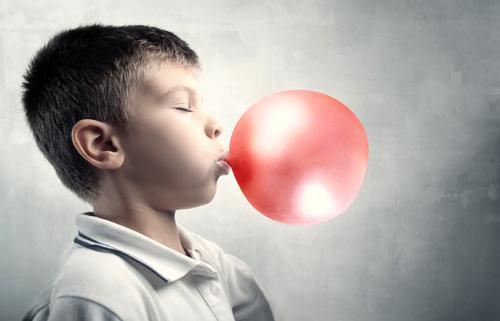 little boy blowing bubblegum 3