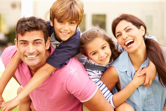 happy children piggybacking on their parents 2
