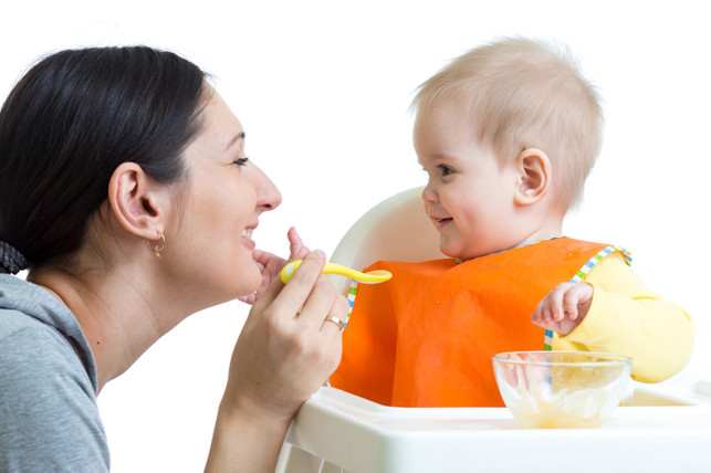 mother feeding her baby food - Toddler Dentist in Katy, TX